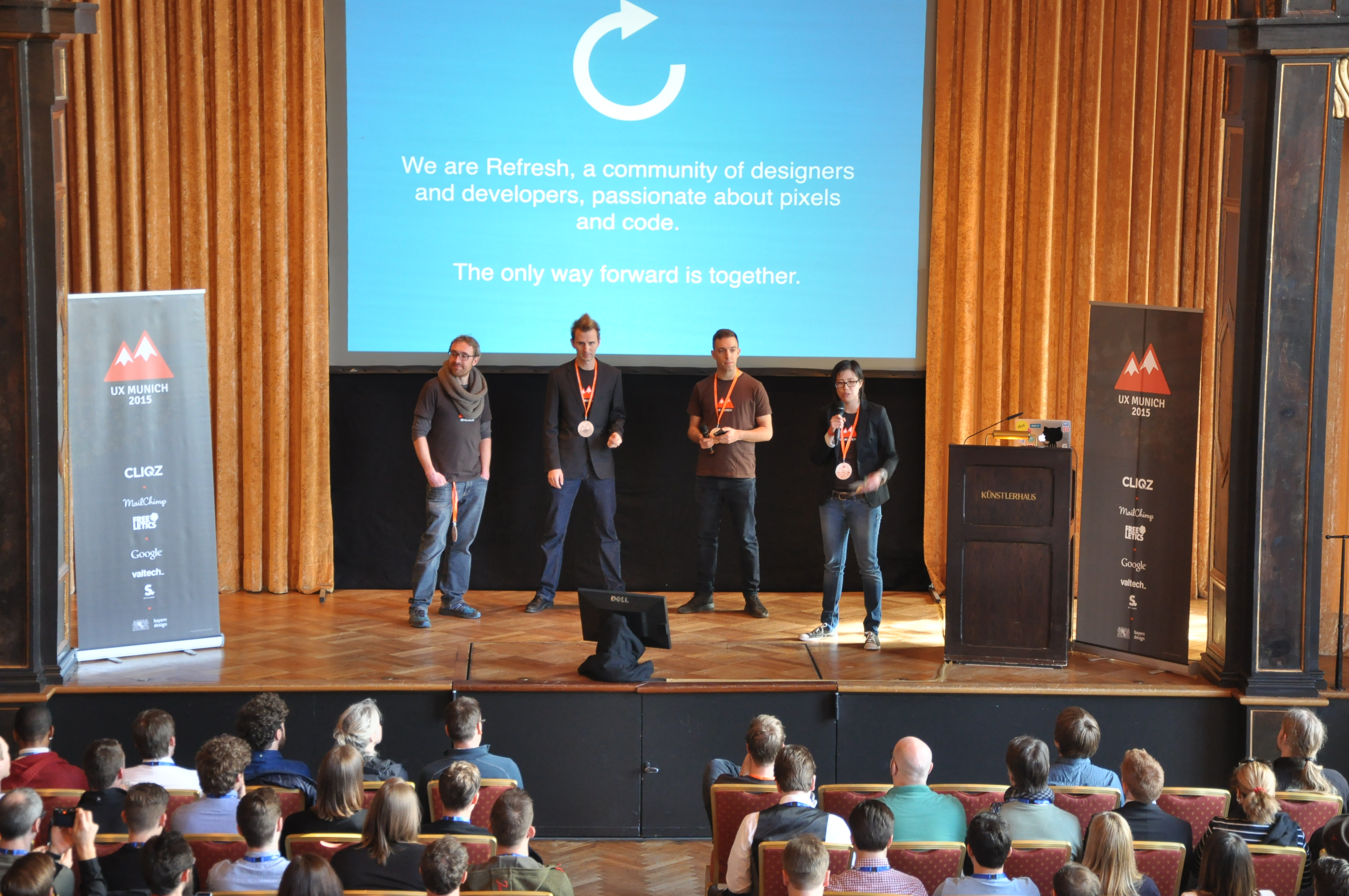 On stage at UX Munich 2015 with my co-founders and co-organizers